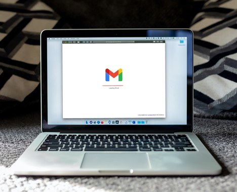 laptop with Gmail logo
